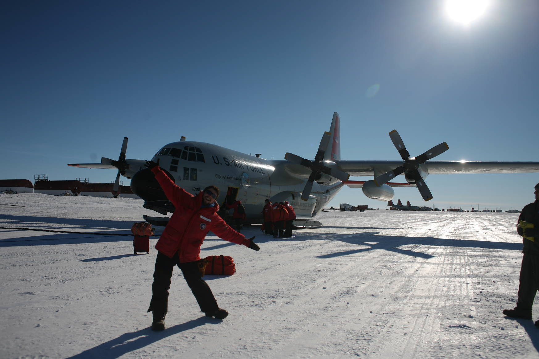 Excited, in front of the LC-130 ski-equipped Hercules.