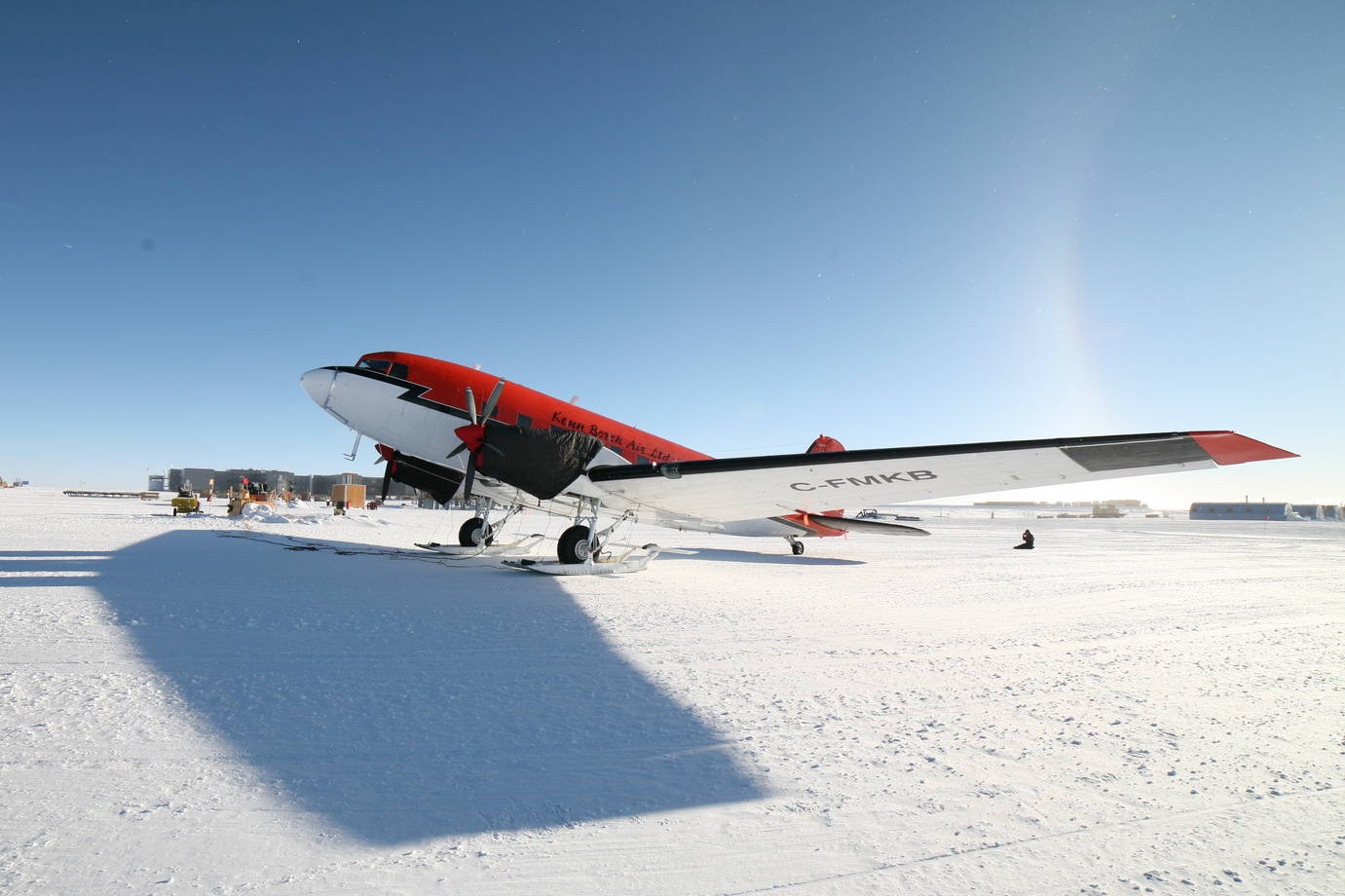 A Basler aircraft parked in front of the south pole station.