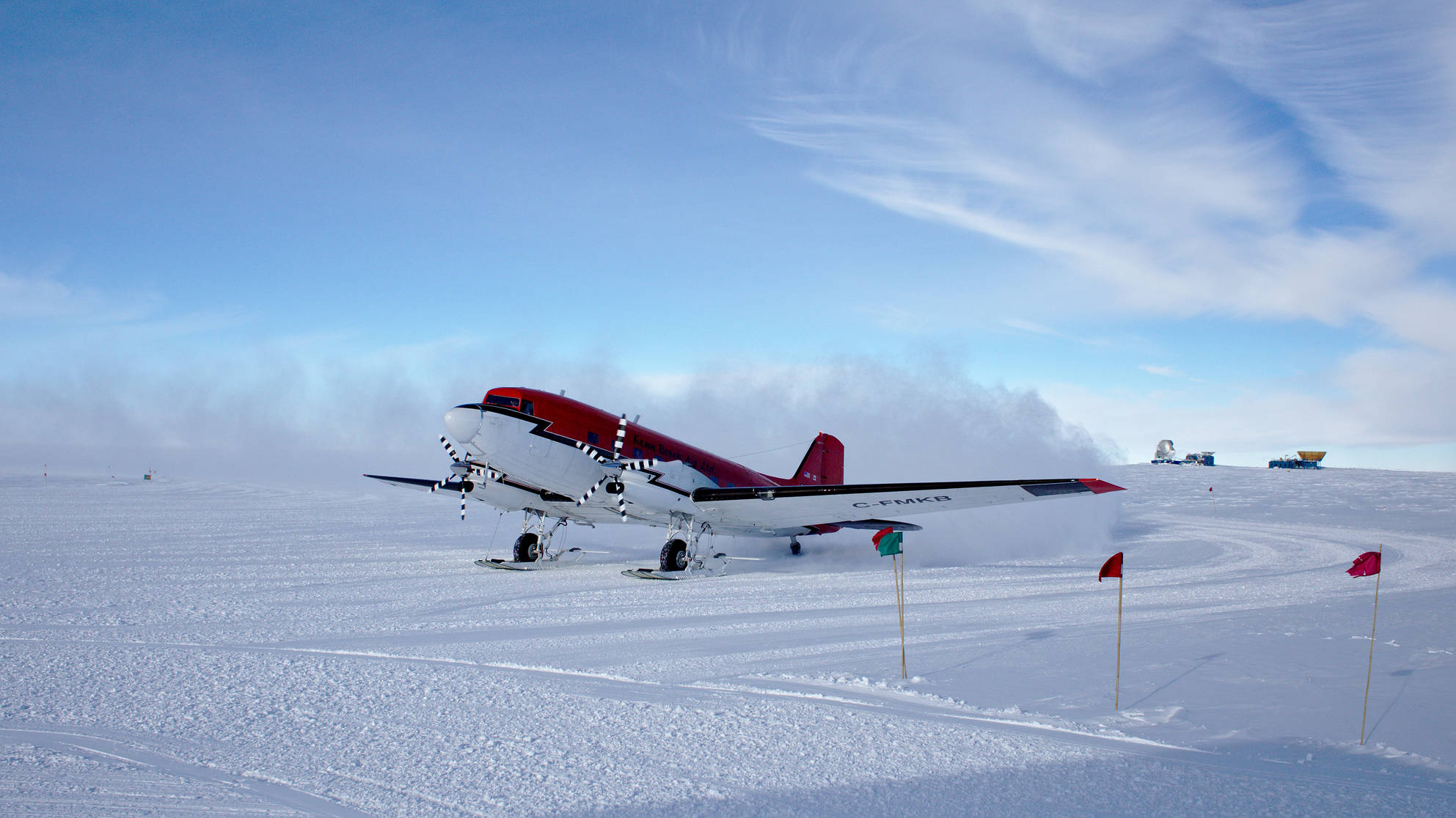 Basler arriving at south pole. In the background the South Pole Telescope, BICEP, and SPUD